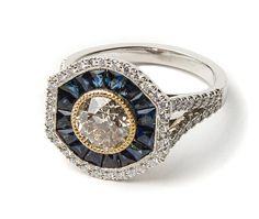 Ring in platinum with 1.36 ct. diamond center, 1.5 cts. t.w. sapphires, and 0.51 ct. t.w. diamonds, price on request; Lord Jewelry