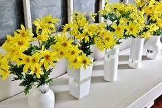 Easy way to transform old glass vases with spray paint and painter's tape.