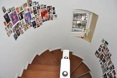 Photos on a staircase without frames.