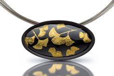 Lara Ginzburg - Ginkgo Leaves (black and gold) | Enamel over copper, 24K gold gingko leaves, sterling silver settings, textured back plate | Brooch/pin convertible to pendant.