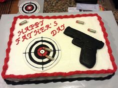 Gun Cake: gun is a sugar cookie decorated with royal icing, target hand made with royal icing, bullets are modeling choc. painted with dry luster dust.