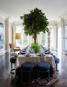 19 dining spaces you would be proud to have in your home: This light-filled dining space in the home of Melbourne philanthropists Sid and Fiona Myer, features low stools, perfect for accommodating large numbers (such as for a Dom Perignon soirée) without overwhelming the space.