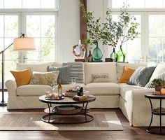 Living room with beige couch and pops of orange, teal and blue