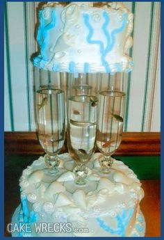 I want a beach themed wedding cake.  yes. perfect.  the live fish in the flutes is the perfect touch.  just smell that ocean air....