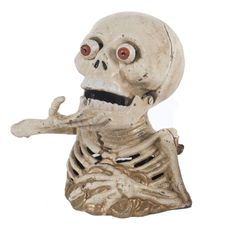 An American skeleton money box, painted cast iron, 16cm high / MAD on Collections - Browse and find over 10,000 categories of collectables from around the world - antiques, stamps, coins, memorabilia, art, bottles, jewellery, furniture, medals, toys and more at madoncollections.com. Free to view - Free to Register - Visit today. #MoneyBanks #MADonCollections #MADonC