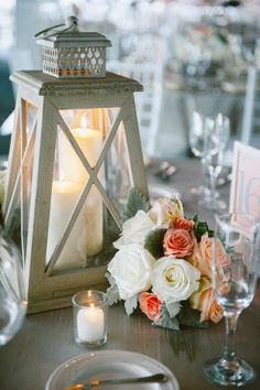 Lantern and Flower Wedding Centerpiece. Peach, coral, mint, ivory, grey. Roses, succulents, tulips, dusty miller. Florals by Jenny