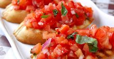 This appetizer or side dish makes a crispy complement to any Italian entree. I just started with my grandmother's bruschetta recipe and added fresh tomatoes! It's one of the yummiest bruschetta recipes I've found. Bruschetta Recept, Tomato Bruschetta, Appetizer Salads, Appetizer Recipes, Appetizers, Grilled Chicken Sandwiches, Roma Tomatoes, Plum Tomatoes, Cooking Recipes