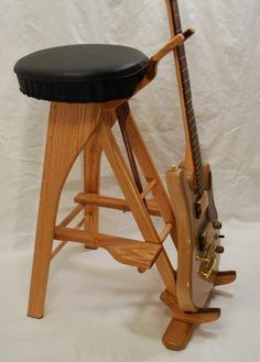 Handcrafted unique wooden guitar stands by South Mountain Woodworks Guitar Chair, Guitar Room, Music Guitar, Woodworking Projects Diy, Woodworking Furniture, Wood Projects, Guitar Storage, Guitar Display, Product Design