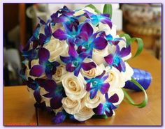 White roses and blue orchids bouquet