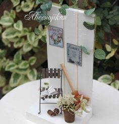 miniature house, book