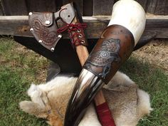 Axe with Jörmungandr on the leather sheath, and drinking horn with Fenrir embossed leather sleeve.