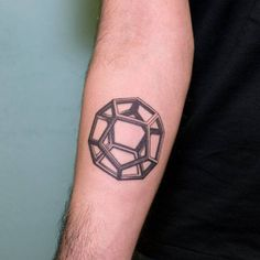 A regular dodecahedron tattoo, one of the five platonic solids. Tattoo Artist: Nano · Ponto a Ponto
