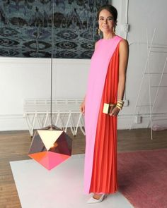 Alison Sarofim in Dior  Wow - this is amazing!! Clashing red and pink plus pleats!