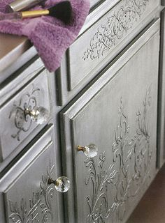 Embossed stenciling on cabinet doors.