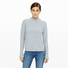 """Our versatile Tommie sweater is a plush merino wool pullover featuring a subtly textured horizontal rib with distinct wide-ribbed cuffs. With an easy-fitting silhouette, this slouchy style exudes an effortless sensibility. Wool Straight fit 22"""" in length from high point of shoulder Mock neck; alllover rib knit; wide rib-knit cuffs Dry clean Imported"""