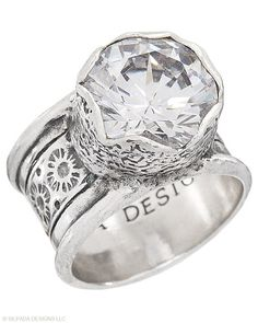 Bring on the bling with this wide-band Sterling Silver and Cubic Zirconia Ring. Whole sizes 5-11. favorite-places-spaces