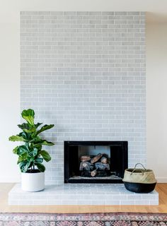 3 Hot Fireplace Tile Trends Mid-century modern fireplace surround in Winter Mountains Glazed Thin Brick Tiled Fireplace Wall, Fireplace Tile Surround, White Fireplace, Farmhouse Fireplace, Fireplace Remodel, Fireplace Surrounds, Fireplace Design, Fireplace Mantels, Fireplace Ideas