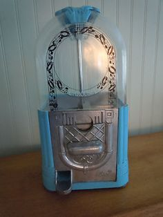 Beautiful blue jukebox style gumball machine by Carousel.