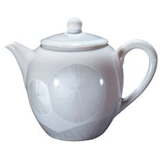 White Pearl Teapot. A white porcelain teapot with crystal glaze makes the perfect teaware to enjoy a vast range of specialty Chinese teas at home.