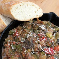 Traditional ratatouille is a thick, hearty and colorful stew-like mass that sticks to your ribs and warms you throughout. Hard to believe it's nothing but vegetables and a bit of cheese. It certainly is peasant food, but peasant food fit for a king.
