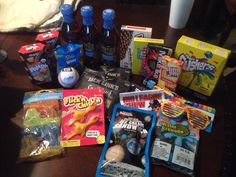 Summer care package. Included fun summery candy and treats... Sweet tea, freeze dried ice cream, water guns, flicking chickens, a baseball and his baseball glove.. Bubble gum, silly bright sunglasses... Fun care package!!