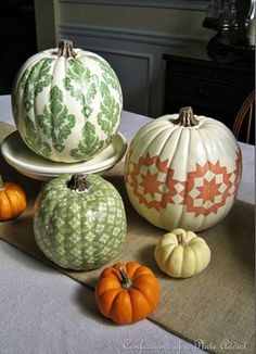 """Decoupaging pumpkins Designer pumpkins  A simple collection of pumpkins can make a bold statement when grouped together, particularly if you find ones in interesting colors. """"If you gather not-quite-ripe pumpkins, they are green and off-white and look beautiful on a mantel,"""""""