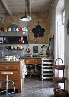 wonderful teapots in this great industrial kitchen