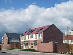 Orchard Park, Hull. A mix of 36, 2 and 3 bedroomed affordable family homes and 16, 1 bedroom apartments built on behalf of Riverside housing association. Croft Goode Architects
