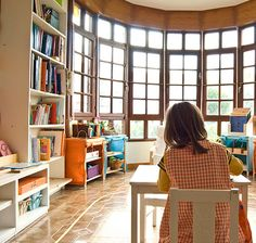 Love the child size furniture coupled with the adult size book shelf...this brings balance to the room and a natural flow of order