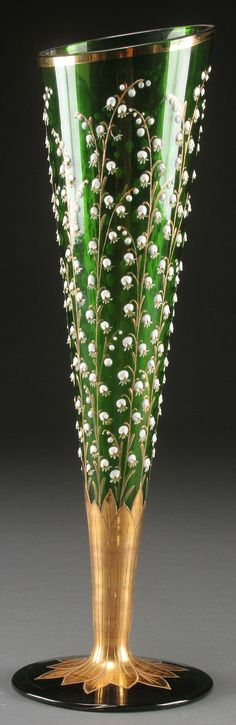 A MOSER BOHEMIAN ART GLASS VASE, EARLY 20TH CENTURY. Of trumpet form decorated all over with enameled Lilies of the Valley and gilt highlights.