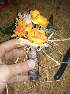 Made these boutiners for my wedding. Camo and orange with shotgun shells wrapped in camo gorilla tape