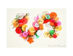 Button charm bracelet yellow orange red by ClairesLegacyJewelry, $24.38  SUMMER SALE! COUPON CODE TEAM20 FOR 20% OFF!