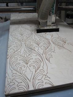 CNC cutting grooves in nice Baltic birch forartist Scott Campbell. Scott and crew pack all of these grooves with cannon fuse (yes), then paste some special paper over it and thenthey LIGHT IT ON FIRE!It looks pretty damn awesome too. Files from Adobe Illustrator, cut on the CNC router.