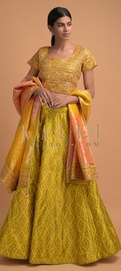 Buy Online from the link below. We ship worldwide (Free Shipping over US$100)  Click Anywhere to Tag Corn-Yellow-Lehenga-And-Crop-Top-With-Ikkat-Weave-And-Gotta-Embroidery-Online-Kalki-Fashion