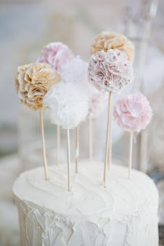 Shabby chic baby shower cake - love the simple fabric pompom cake topper!