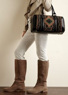 Plush suede tall boots and tribal bag.