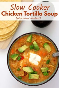 Slow Cooker Chicken Tortilla Soup—tortilla soup that is made with actual tortillas! The corn tortillas slow cook along with the bites of chicken, tomatoes, veggies and broth and then they thicken the soup into a lovely consistency. You're going to love this simple way to make real tortilla soup! #slowcooker #crockpot #soup