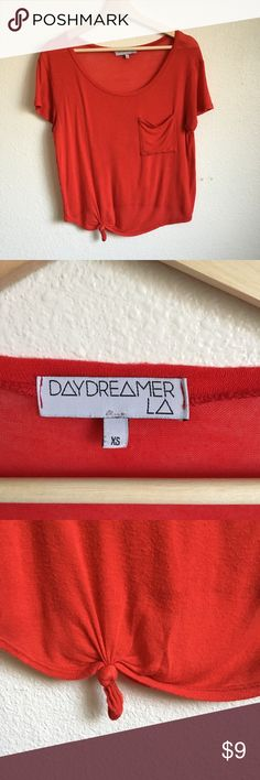 Daydreamer LA Tie-front Pocket T-shirt Red tie-front pocket t-shirt from Daydreamer LA, purchased from Urban Outfitters. Size small. Lightweight cotton, great for a casual look. Worn but with lots of life left in it. Small hole near the bottom (see last photo). Urban Outfitters Tops Tees - Short Sleeve