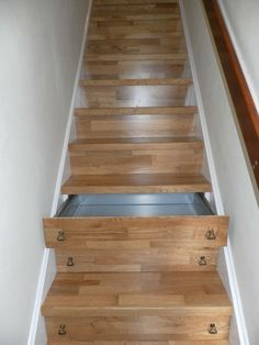Stair drawers. I have been wondering how to do the handles so that they don't become trippers.  These work!