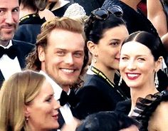 Sam Heughan and Caitriona Balfe on the red carpet at the Golden Globes Awards 2016