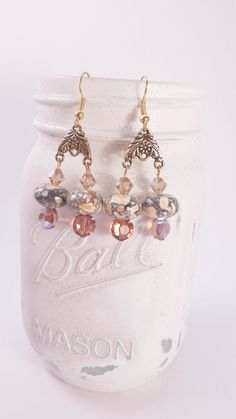 Gold tone and orange marble dangle earring