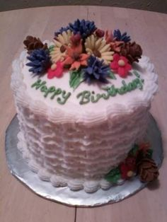 6 inch cake with marshmallow fondant flowers. Frosted in buttercream with frilly basket weave design.