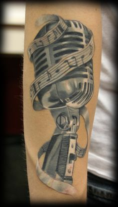 The detail and coloring of this Music Tattoo is pretty intense! If you want to learn Microphone Techniques- Berkleemusic offers a great course ;) Click to learn more.