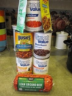 Taco Soup - Brown meat (you can use any ground beef or turkey, put in crock pot with cans of crushed tomatoes, black beans, pinto beans in chili sauce, rotel, and corn. -add packets of each, ranch powder mix and taco seasonings, and the other seasonings -stir and simmer on low for 6-8 hours.