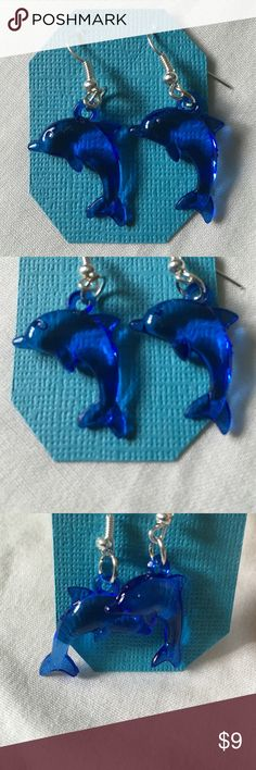 Blue dolphin earrings Royal blue dolphin earrings perfect for any ocean lover! 50% of all our proceeds are donated to Cranio Angel Network and Craniosynostosis support and awareness. Jewelry Earrings