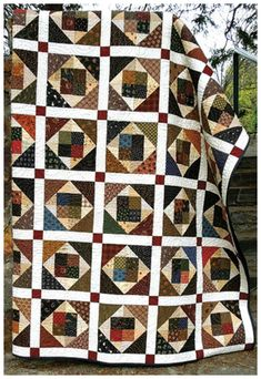 """A great stash buster!This alluring quilt pattern is great for using up your leftover fabric scraps. By laying out your blocks in different ways, you can create a multitude of designs tailored especially for your personality. Make it scrappy looking or create a barn-raising scene -- anything goes! Finished quilt size is 78 1/2"""" x 87 1/2"""". Pattern requires Easy Angles tool."""