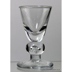 """Dram Glass, c1700. """"A Georgian baluster glass owes its existence to the slower cooling lead  crystal developed at the Savoy glass house. The glass was not suited to the production of the earlier Venetian styles with thin and light funnel shaped bowls"""" (Scottish Antiques)"""