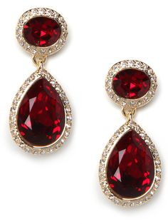 These stunning earrings are dripping with that royal je nais sais quoi. Reminiscent of the ruby red earrings worn by Queen Olga of Greece, they feature two giant crimson gemstones, framed by crystals.