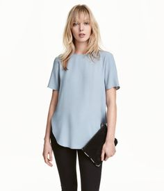 Gray blue. Short-sleeved top in crêped, woven viscose fabric. Straight fit with opening at back of neck with concealed button. Rounded hem.