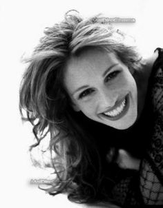 Julia Roberts' wide smile--like Katie McClure's